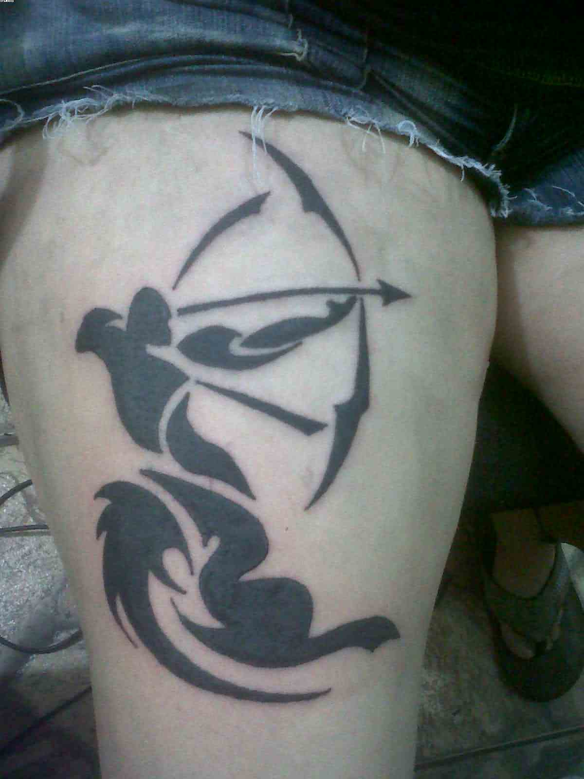 New Tribal Sagittarius Tattoo On Thigh