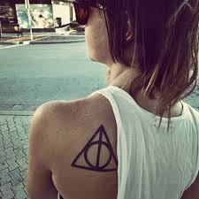 Nice Black Outline Symbol Tattoo Behind Left Shoulder
