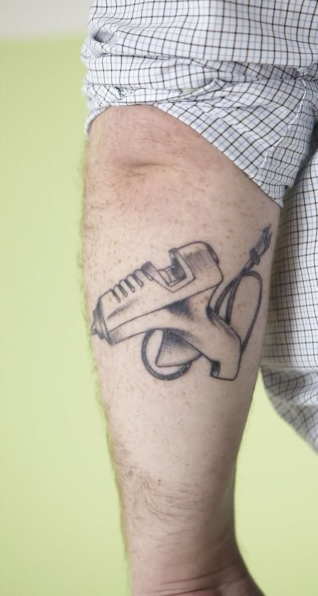 Nice Glue Gun Tattoo For Men