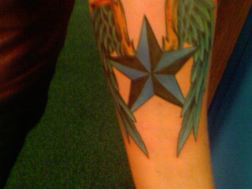 Nice Nautical Star With Colorful Wings Tattoo On Arm
