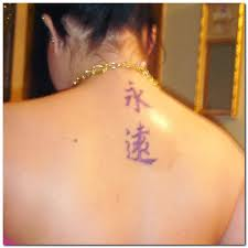 Nice Purple Symbol Tattoos On Upperback