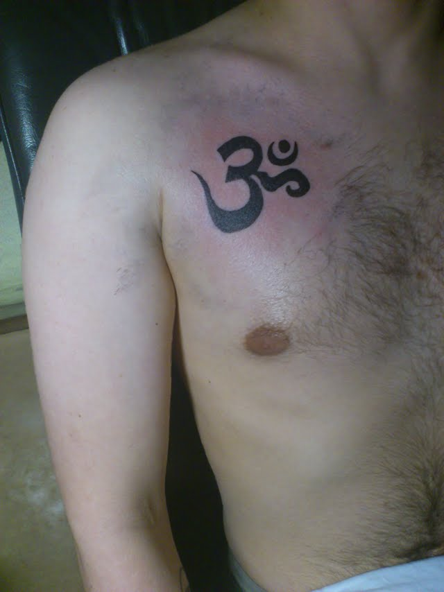 Ohm Symbol Tattoo On Right Front Shoulder