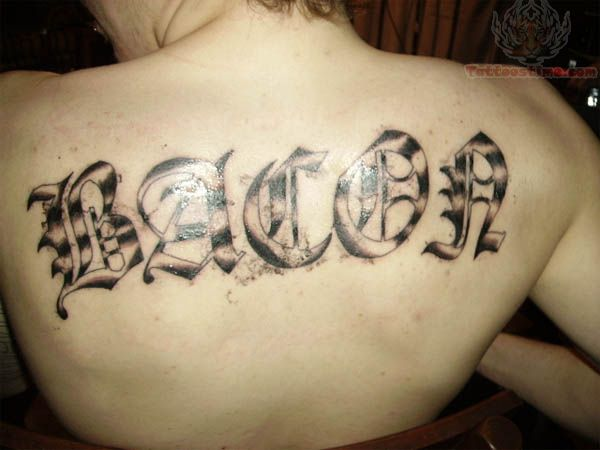 Old English Word Tattoo On Upperback
