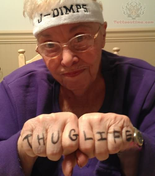Old Lady Showing Thug Life Tattoos On Fingers