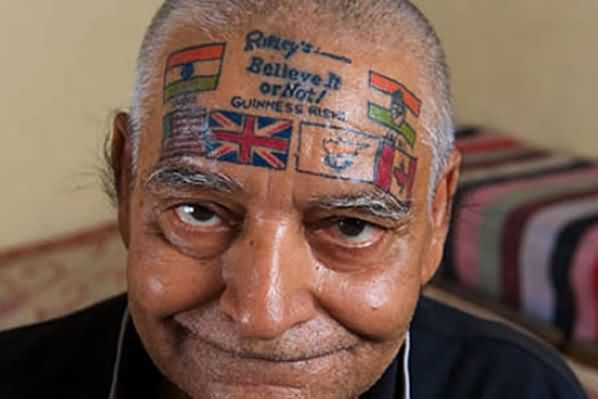 Old Man With Patriotic Tattoos On Forehead