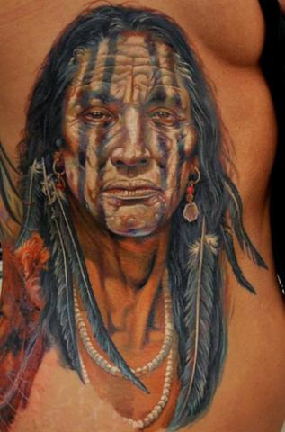 Old Native American Totem Pole Tattoo On Side