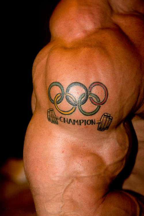 Olympic Champion Tattoo On Muscles