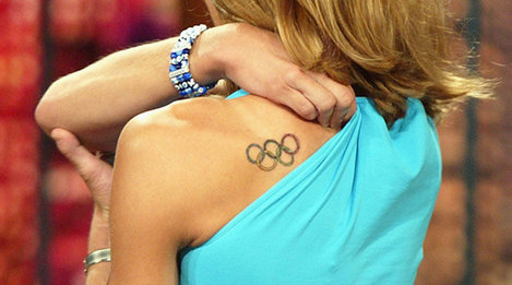 Olympic Rings Tattoos Behind Left Shoulder
