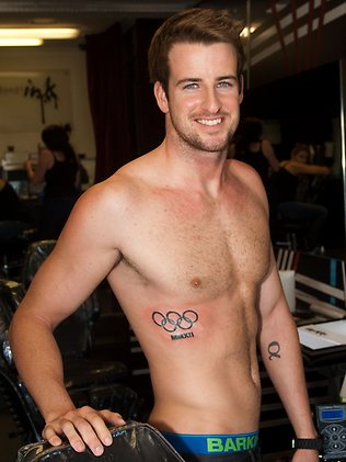Olympic Rings With Roman Numeral Tattoos On Side Stomach