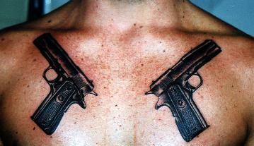Original Black Pistol Tattoos On Upper Chest