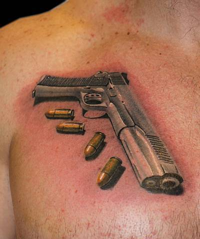 Original Pistol And Golden Bullets Tattoos On Chest