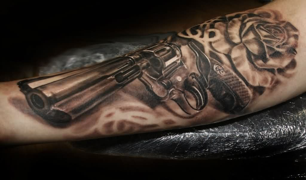 Original Pistol And Rose Tattoos On Arm