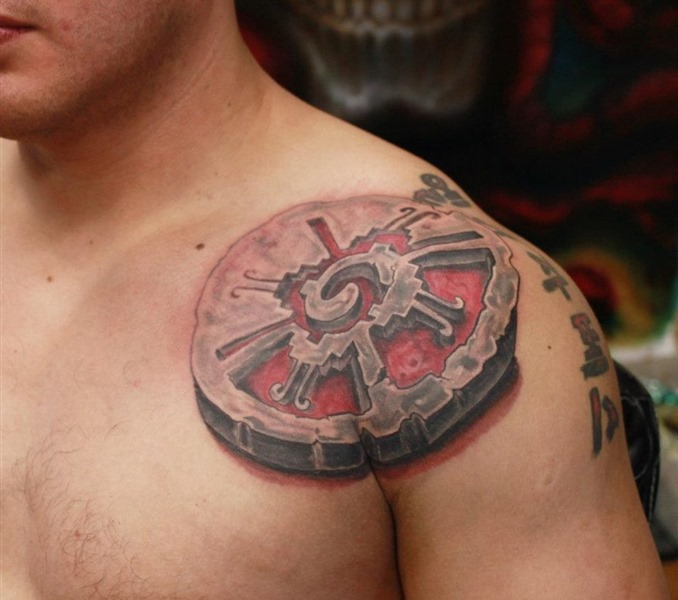 Original Stone Mayan Symbol Tattoo On Front Shoulder