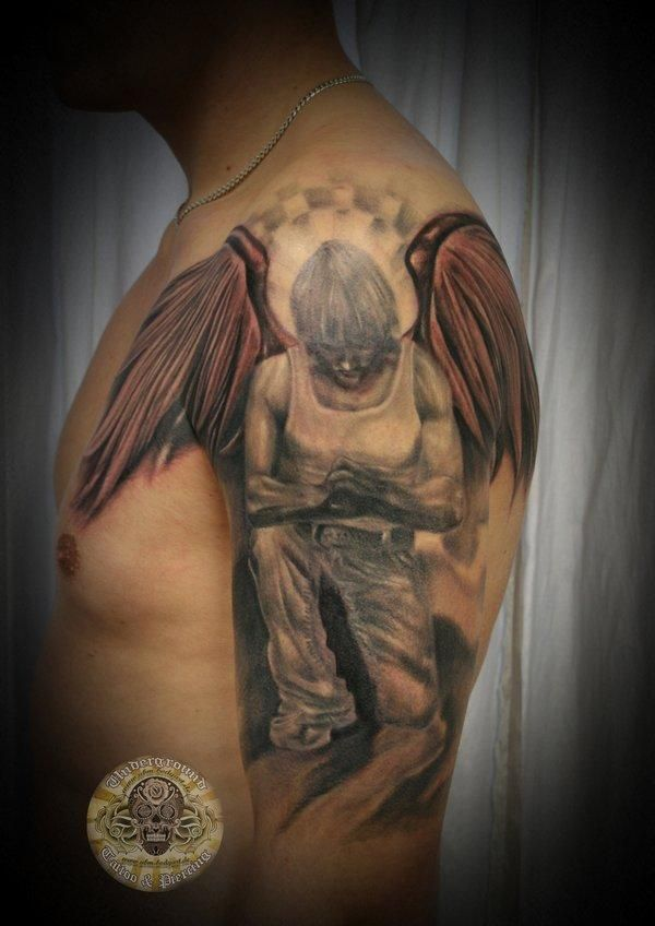 Original Thug With Angel Wings Tattoos On Arm