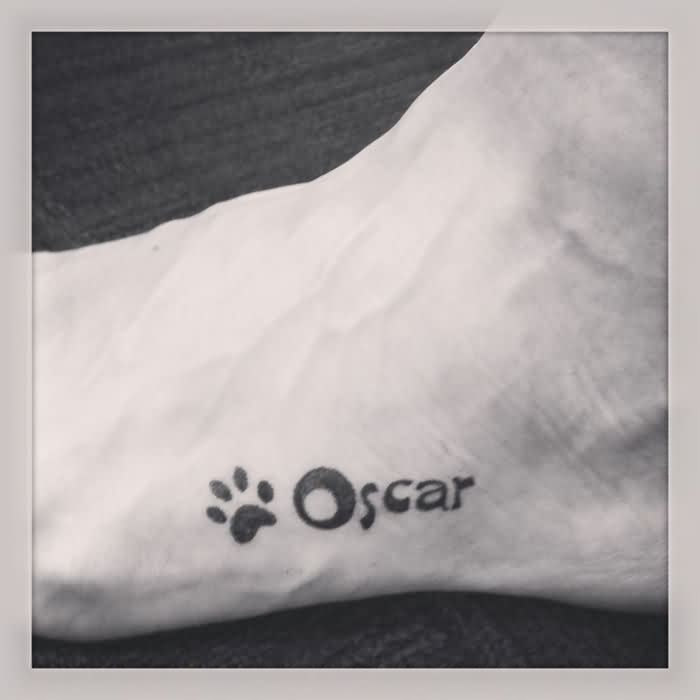 Oscar Paw Print Tattoo On Foot
