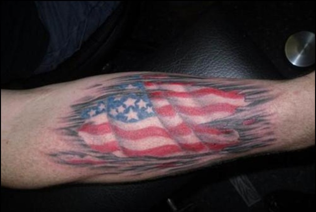 Patriotic American Ripped Skin Tattoo On Arm