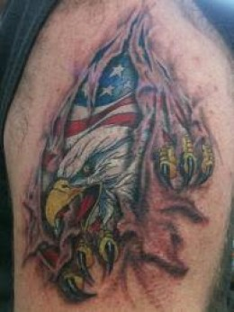Patriotic Eagle Ripping Through Skin Tattoo On Biceps