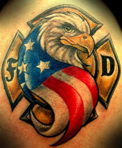 Patriotic Eagle Tattoo In Front Of Fire Fighter Cross Tattoo