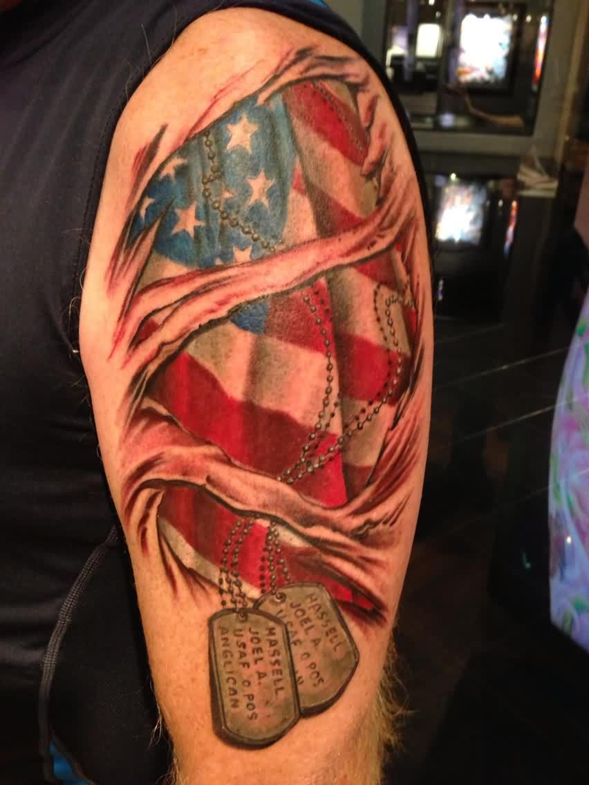 Patriotic Flag Ripped Skin Tattoo On Arm
