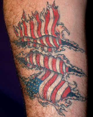 Patriotic Flag Ripped Skin Tattoo