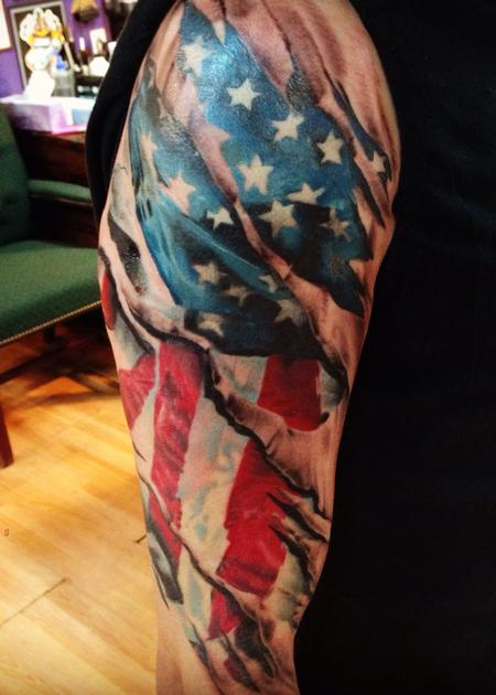 Patriotic Flag Skin Tear Tattoo On Sleeve
