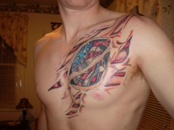 Patriotic Ripped Skin Tattoo On Chest