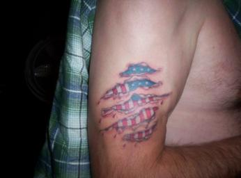 Patriotic Torn Ripped Skin Tattoo On Muscles