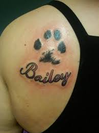 Paw Print And Name Tattoos Behind Shoulder