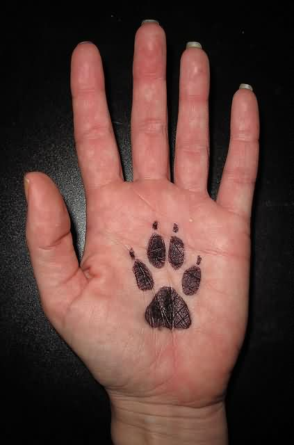 Paw Print Palm Tattoo
