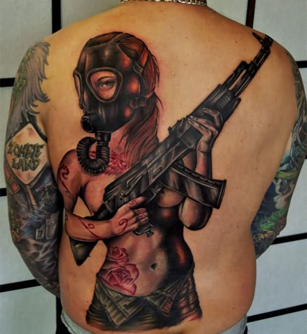 Pin Up Gas Mask Girl With A Black Machine Gun Tattoo On Back