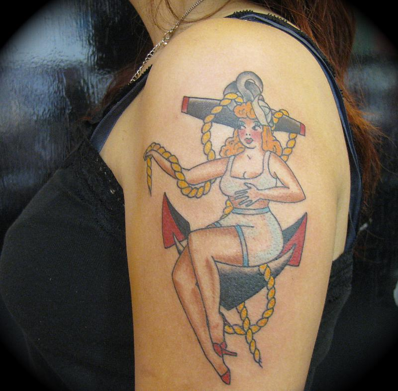 Pin Up Girl On Anchor Tattoo On Arm