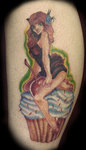 Pin Up Girl On Cherrry Cupcake Tattoo