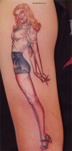 Pin Up Girl Standing Tattoo On Arm