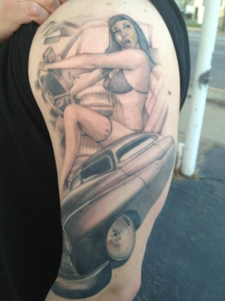 Pin Up Girl Steering Car Wheel Tattoo On Arm