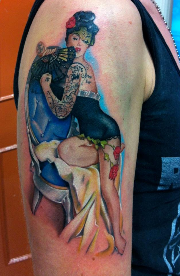 Pin Up Girl With Japanese Fan Tattoo On Arm