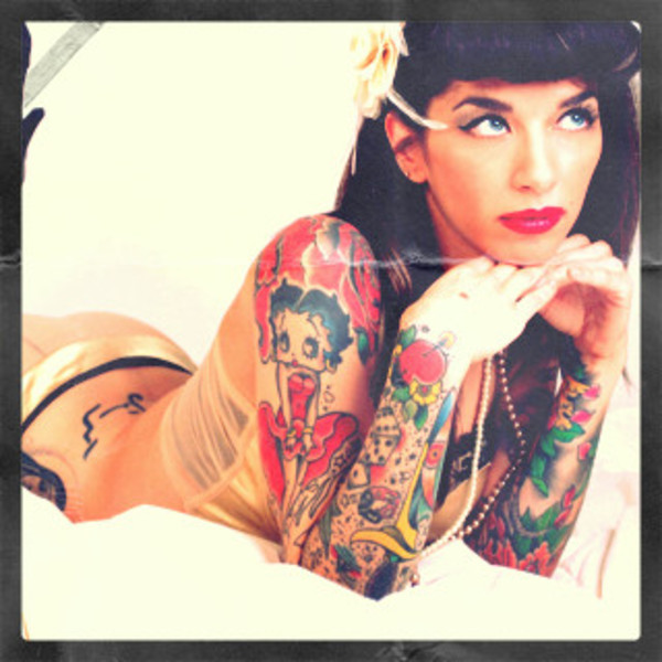 Pin Up Girl With Tattoos On Arm