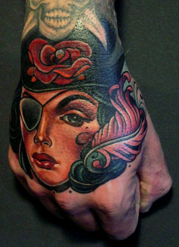 Pirate Girl With Rose Cap Tattoo On Hand