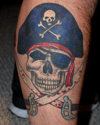 Pirate Skull And Bleeding Swords Tattoos On Leg