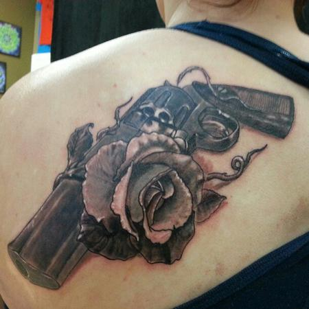 Pistol And Rose Close Up Tattoo