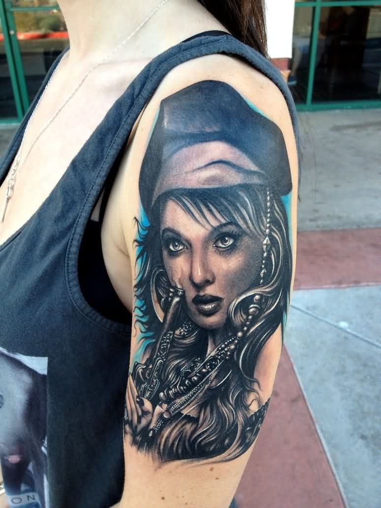 Pretty Female Pirate With Revolver Tattoo On Arm