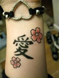Pretty Flowers Symbol Tattoos And A Heart Bracelet