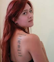 Pretty Lady With Chinese Symbol Tattoos On Back Shoulder