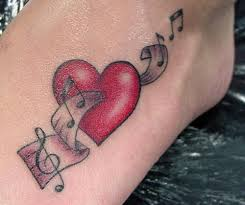 Pretty Music And Red Heart Symbol Tattoos On Foot