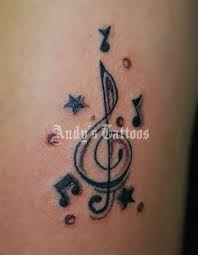 Pretty Music And Star Symbol Tattoos
