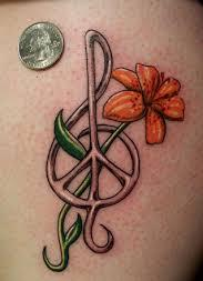 Pretty Music Symbol And Orange Flower Tattoo