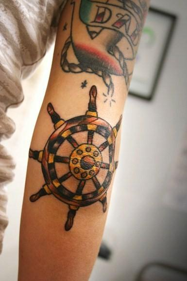 Pretty Nautical Wheel Tattoo On Elbow
