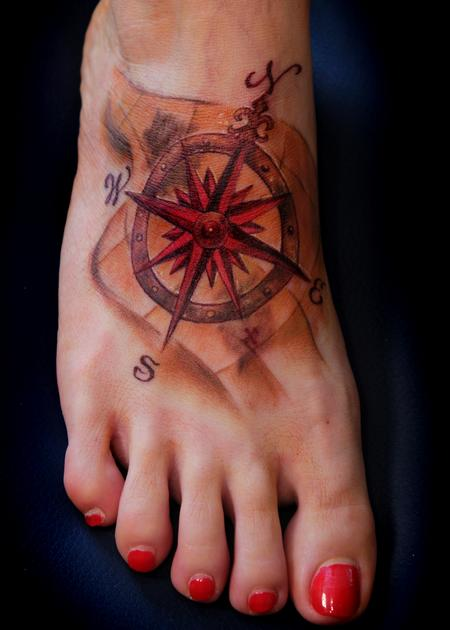 Pretty Red Ink Nautical Compass Tattoo On Foot