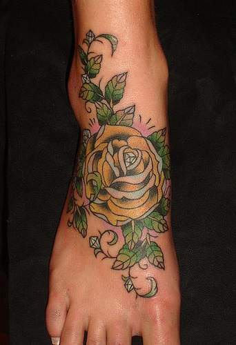 Pretty Yellow Rose With Green Leaves Tattoos On Foot