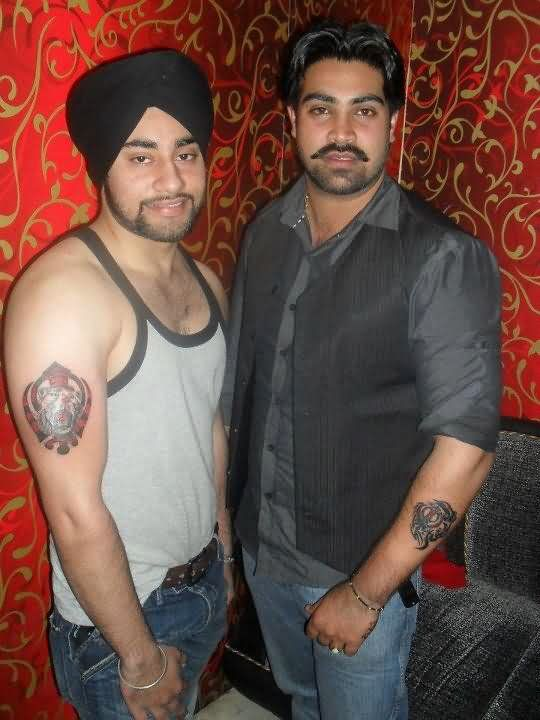 Punjabi Dudes With Lion Head And Khanda Tattoos