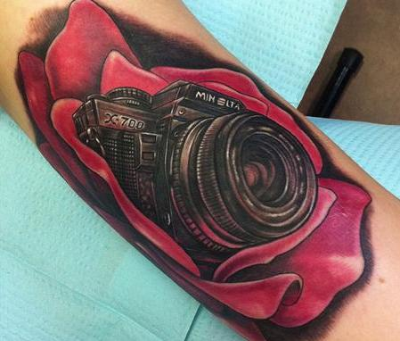 Realistic Black Camera In Rose Tattoos